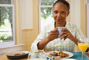getty_rf_photo_of_woman_eating_breakfast